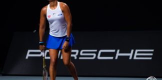 Naomi Osaka of Japan in action during her RR1 match 2019 WTA Finals tennis tournament